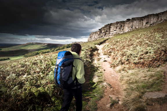 A walker approaching Stanage Edge