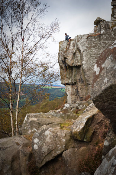 Two climbers on Curbar Edge in the Peak District National Park Derbyshire