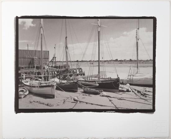 Essex Smacks at their moorings in the old Aldous Smack dock in Brightlingsea Essex.