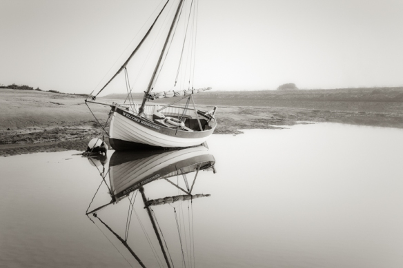 Welcome Messenger at low tide Burnham Overy Staithe