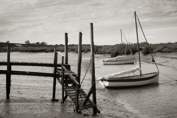 Boats at their moorings in a Norfolk Creek